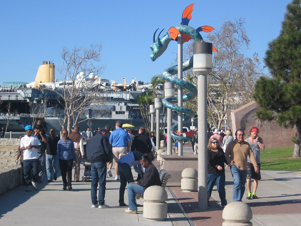 Visitors to San Diego's Embarcadero walk past a looming dragon!