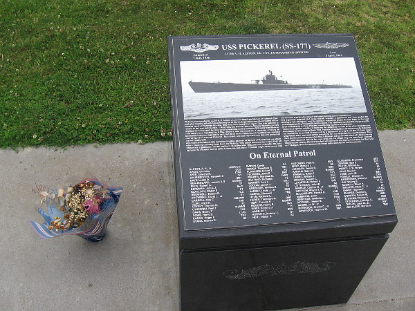 Someone honors submariner heroes by leaving flowers beside a black granite marker that remembers the USS Pickerel (SS-177).