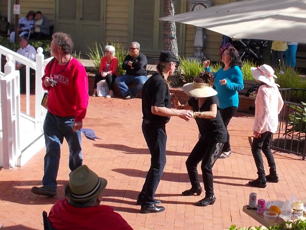 Visitors to Seaport Village in San Diego rock out to the Bayou Brothers!