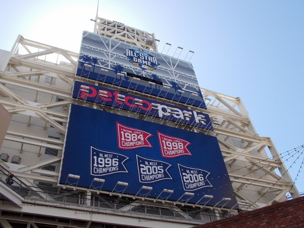 Sign on back of the huge videoboard highlights the team's past accomplishments. This year Petco Park will host the 2016 MLB All-Star Game!