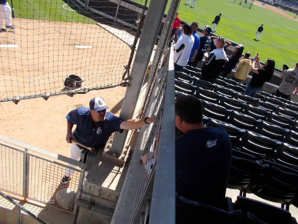 A lucky fan in the stands gets an unexpected autograph from the Padres bullpen!