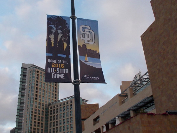 The upcoming All-Star Game appears on a street lamp near Petco Park. These banners can now be seen around East Village.