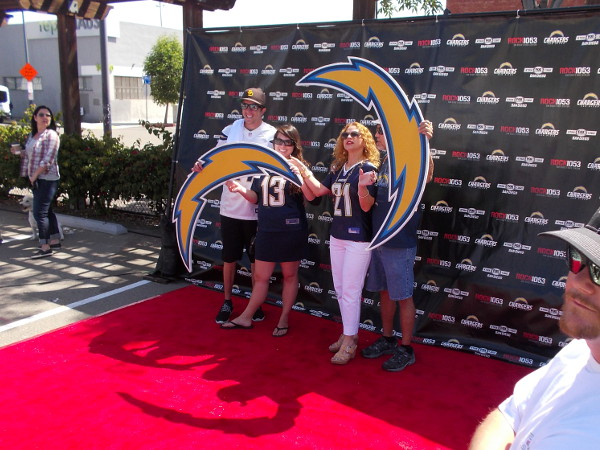 Chargers football fans hold huge bolts for a photograph!