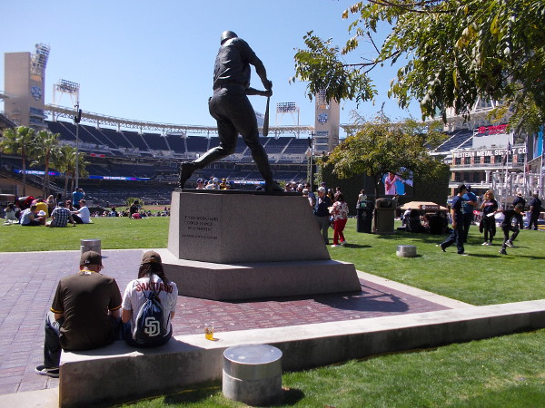 Padres fans rest behind the Tony Gwynn statue atop the hill in the grassy Park at the Park.