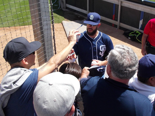 Superstar pitcher James Shields signs autographs for lots of excited fans during 2016 FanFest at Petco Park.