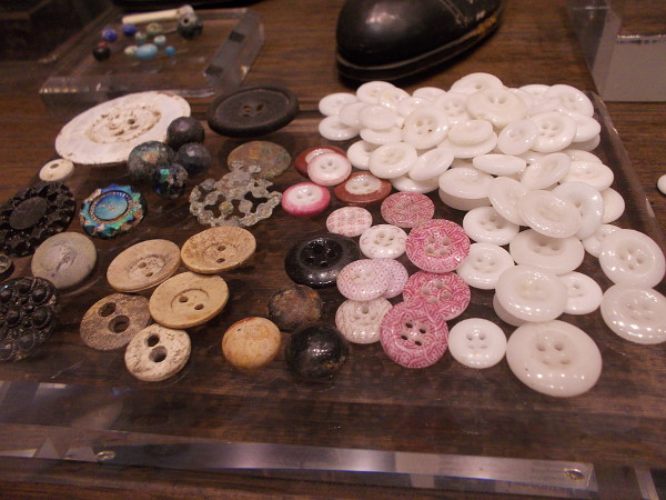Dozens of buttons on display. They were fastened by many fingers, now long gone.