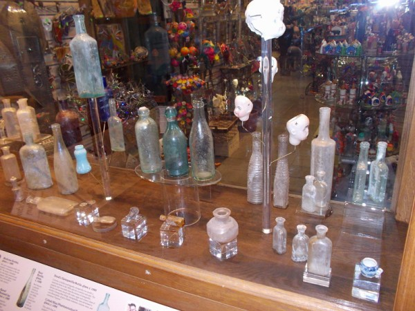 People interested in collecting antique bottles would be mesmerized by the large assortment on display.