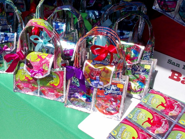These shiny, colorful handbags were made from recycled Kool-Aid and Capri Sun packets!