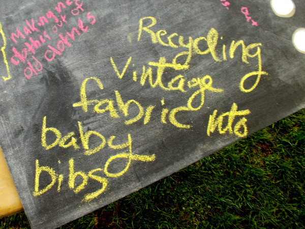 Recycling vintage fabric into baby bibs.