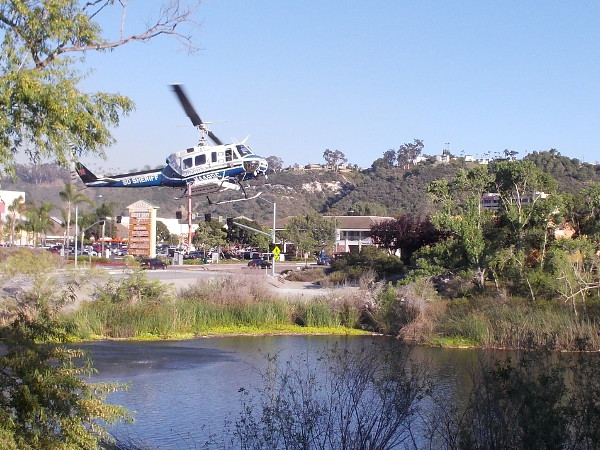 A couple minutes later one of the San Diego County Sheriff's three firefighting helicopters arrives! You can see the external belly tank underneath the chopper's body!