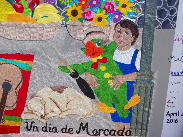 A smiling face, a funny parrot, an umbrella, guitar, flowers, fruit and a sleeping dog. One day at the market!