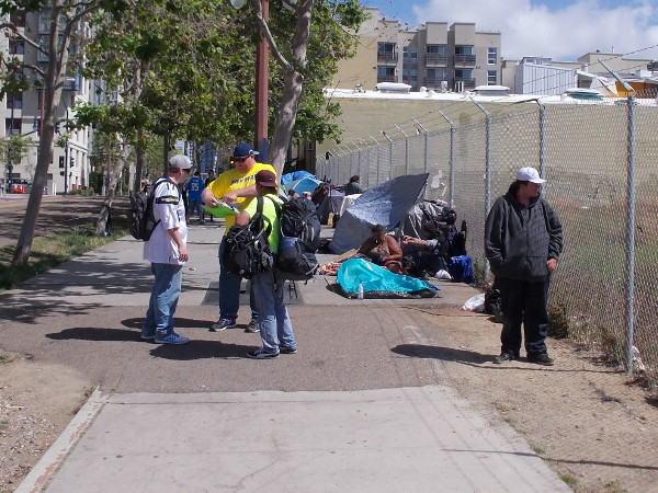 Petitions were being signed on the sidewalk along Park Boulevard, where many homeless people camp in San Diego.