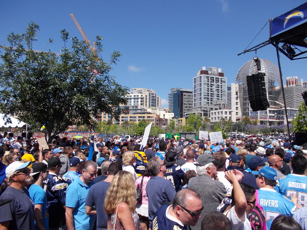 A fairly large crowd has gathered in the parking lot near Petco Park where Padres fans often tailgate. The proposed stadium would be built here.