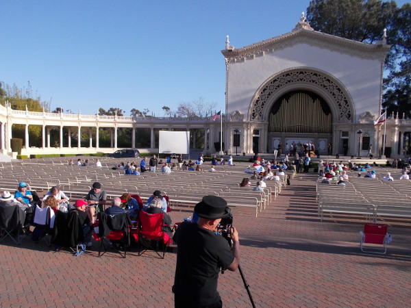 Before the celebration concert, a photographer gets ready and organ enthusiasts have a special dinner in the Spreckels Organ Pavilion.