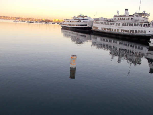 Hazard. One word warns of unseen danger under the smooth, peaceful water of San Diego Bay.