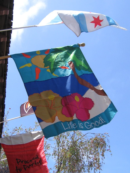 Colorful banner fluttering in the sea breeze proclaims Life is Good. I always enjoy walking past Alamo Flags in Seaport Village.