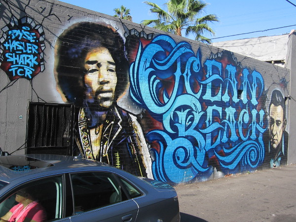 Super cool street mural in Ocean Beach depicts music legends Jimi Hendrix and Johnny Cash.