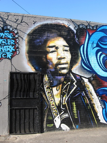 The immortal Jimi Hendrix gazes out from an OB wall.