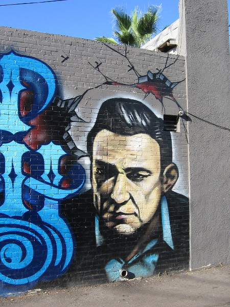 The face of Johnny Cash spray painted in Ocean Beach.