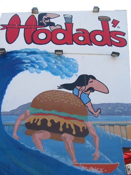 Long hair and a long nose...and a surfing hamburger. The famous Hodad's in Ocean Beach is a popular destination for many hungry people in San Diego.