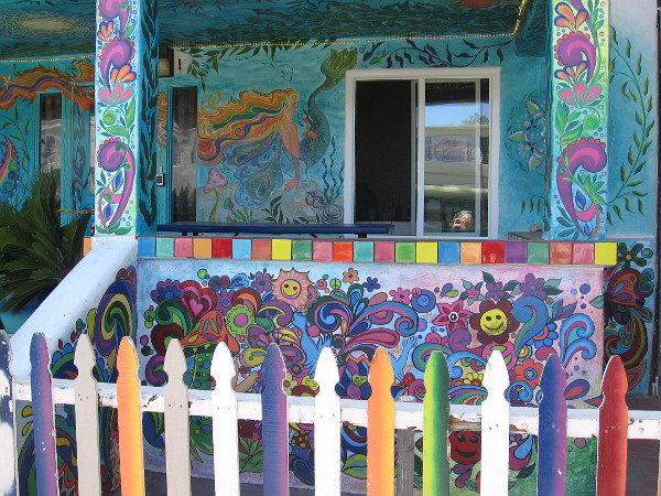 The exterior of USA Hostels Ocean Beach is absolutely covered with colorful psychedelic artwork.