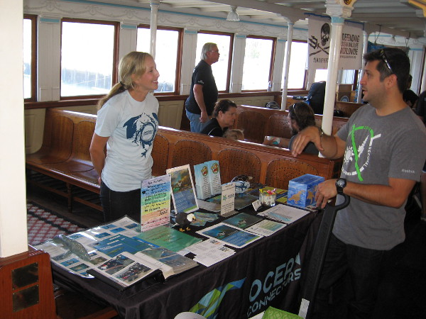 Someone learns about the amazing Eco Tours and the educational programs provided by Ocean Connectors during Earth Bay on the Bay at the Maritime Museum of San Diego.