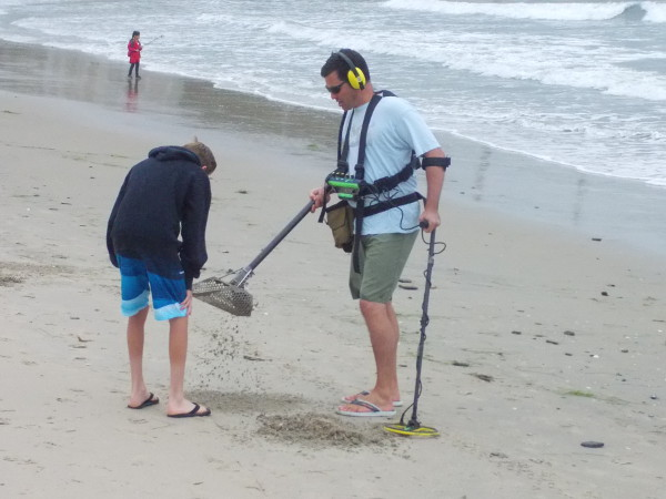 These guys using a metal detector were sifting the sand for precious treasure! In their own way, they help to keep the beach clean, too!