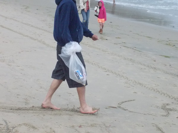Plastic bags filled up with litter as volunteers made Ocean Beach that more beautiful and inviting.