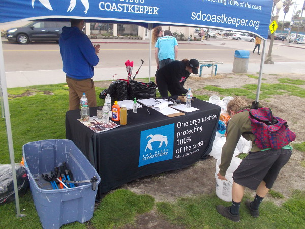 Collected trash is recorded at the San Diego Coastkeeper station not far from the OB pier.