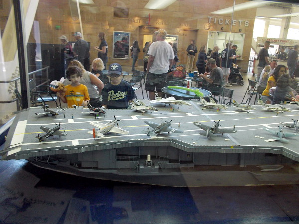 Kids check out the large USS Midway model inside the Power Alley at Petco Park during a Padres game.