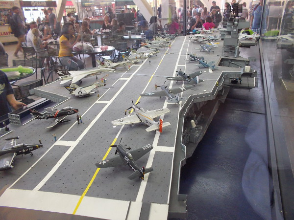 Padres fans eat at tables near an impressive model of the USS Midway, a cool sight inside San Diego's Petco Park.