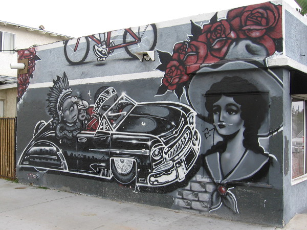 Cool mural in San Diego's hip South Park community features Latino and Native American cultural influences.