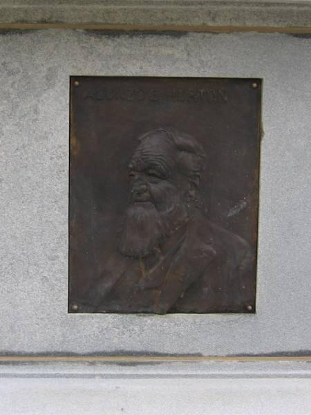 Plaque near base of Broadway Fountain depicts Alonzo E. Horton. He created and promoted New Town, where downtown San Diego exists today. Before being sold to the city in 1895, Horton Plaza was originally used by guests staying at his Horton House Hotel.