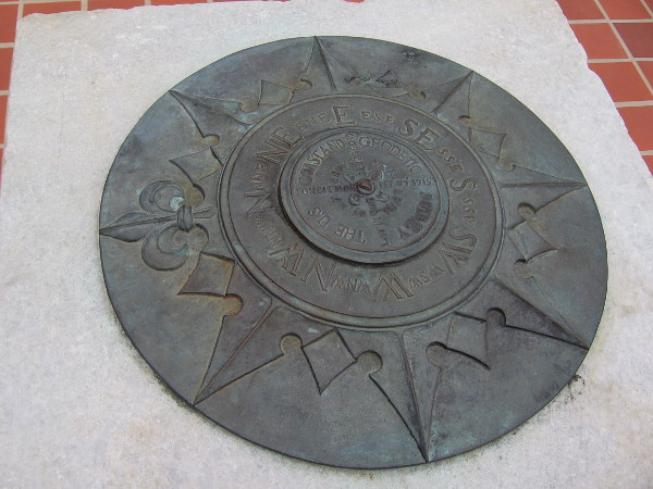 The points of the compass cap the Pacific Milestone.