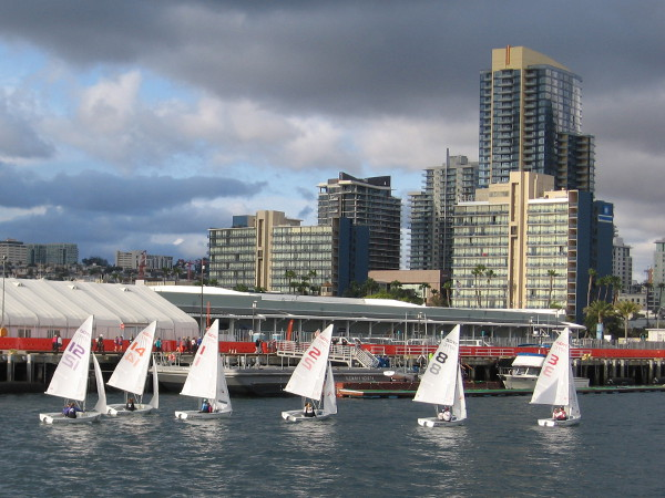 ICSA Women's Semifinals on San Diego Bay. Competing sailboats approach downtown's Cruise Ship Terminal.