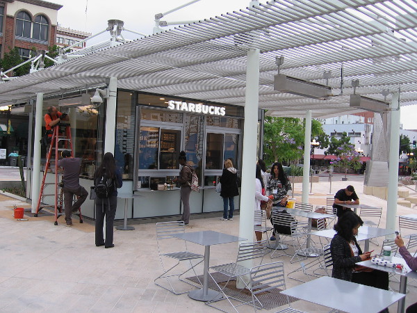 Starbucks occupies one of three food pavilions at the new Horton Plaza Park. The morning after the park's grand opening, this Starbucks is already busy.