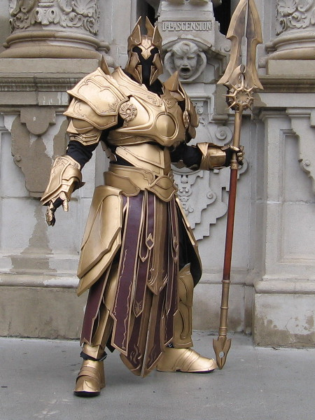 Truly amazing cosplay! A warrior in incredible golden armor seems to have emerged from Lord of the Rings, Arthurian legend, Game of Thrones...or the mists of the distant past. (San Diego Comic-Con is coming in two months! I can't wait! I'll be capturing loads of cool pics!))