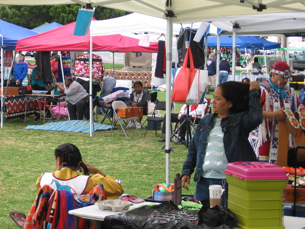 Many who'd arrived for the pow wow were already in colorful ceremonial costume. The earlier rain had ceased and people were relaxing, enjoying friendship, spirit-filled music and another beautiful day.
