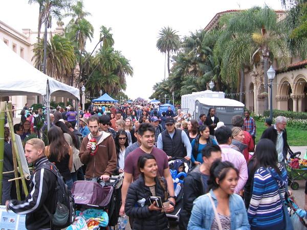 A huge crowd walks down El Prado in Balboa Park, enjoying exhibits and entertainment celebrating the world-famous San Diego Zoo.