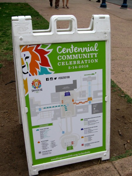 Sign lists the various activities at the San Diego Zoo Centennial community celebration.
