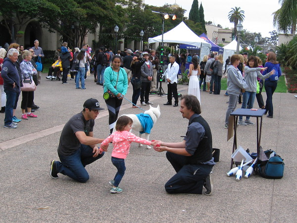 Street magician excites a kid.