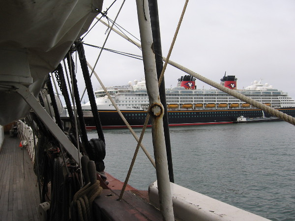 Containing many pleasures, the Disney Wonder cruise ship is docked in San Diego. Seen from the deck of the Star of India.