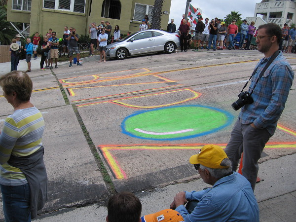 Someone wrote a big word on the street with colorful chalk. I think it reads Bizipoz. I'm not sure, though.