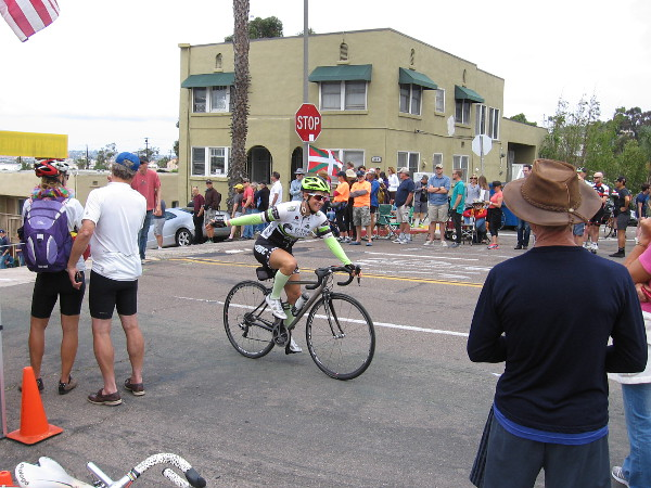 Ordinary people riding up the hill before the race were cheered and spurred forward with cowbells.