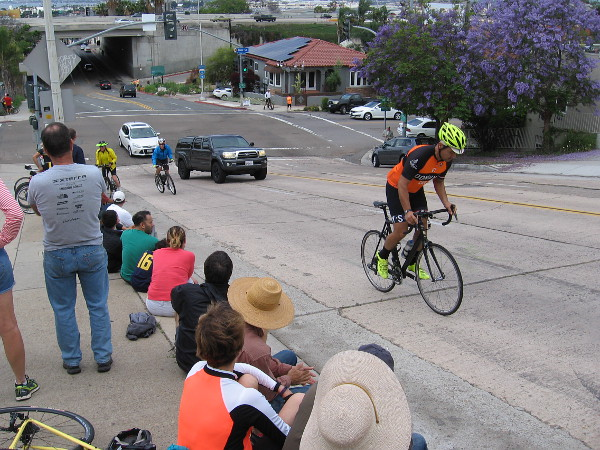 Some more bike lovers showing up a few minutes before the pro racers should pass through.