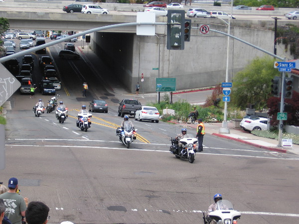 They race is almost here! A huge line of motorcycle cops and Highway Patrol cars, along with tour official and VIP vehicles, parades past for several minutes.