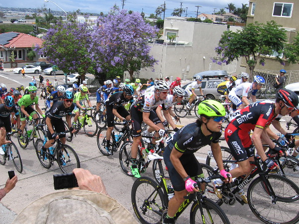 Hoping for glory, bicyclists in the Tour de California power up Laurel Street hill in San Diego.