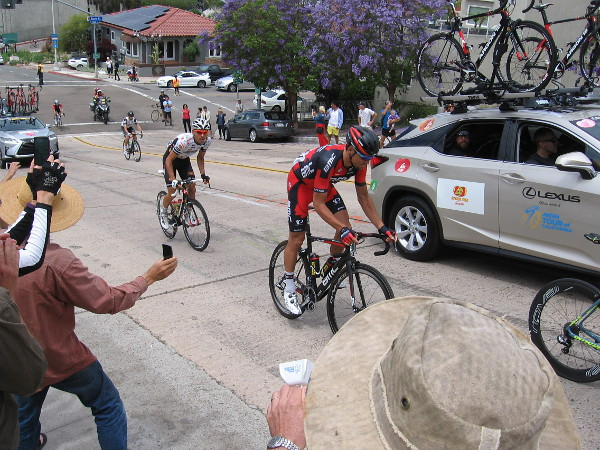 Some cyclists at the end of the main group were intermixed with team support vehicles.