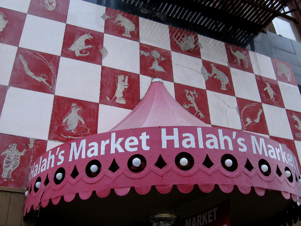 Halah's Market in downtown San Diego has a storefront with some amazing old circus artwork. After a little searching, I found nothing about the history of this building.