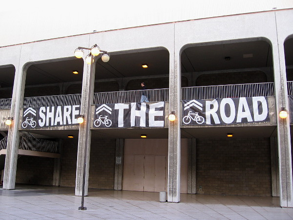 A huge Share The Road banner hung in Civic Center Plaza.